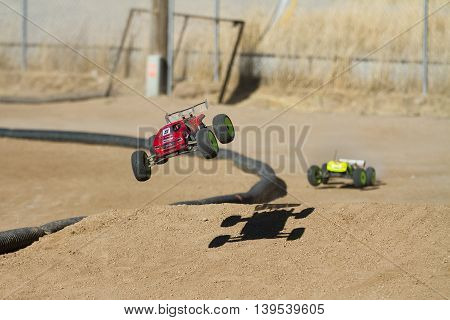 BOISE IDAHO-JULY 16 2016: truggy taking off the ram being chased by another racer at the Boise Summer Blast points race