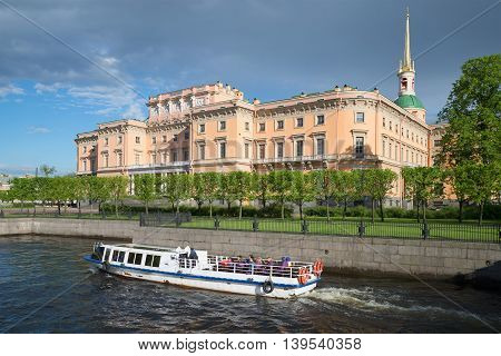 SAINT PETERSBURG, RUSSIA - MAY 24, 2015: Pleasure boat on the water tours at the Mikhailovsky castle. Tourist landmark of the city Saint Petersburg