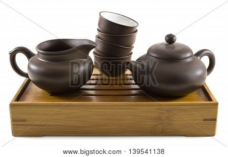 Set of dishes for chinese tea ceremony on tray, isolated on white