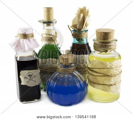 Glass bottles with magic remedies isolated on white