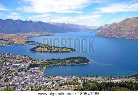 Scenic view of Queenstown and surrounding rugged mountain range (The Remarkables) on the shores of the glacial Lake Wakatipu, New Zealand poster