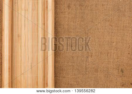 Bamboo mat twisted in the form of a manuscript on sackcloth with space for your text