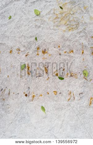 Crushed greasy paper background with thyme leaves
