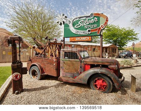 Historical truck and old advertising signs. Wild West museum at Holy in The Rock, Utah, USA. May 15, 2016