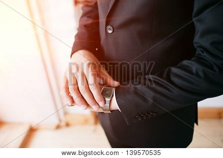 Deadline, Businessman looking at watch, investor, Time management, Boss costume or suit, Corporate man dress, No face, Delaying the meeting.
