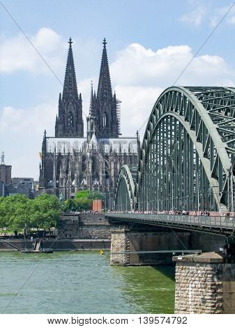 waterside scenery with cologne cathedral and hohenzollern bridge in Cologne a city in North Rhine-Westphalia in Germany