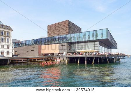 waterside scenery including the Royal Danish Playhouse in Copenhagen the capital city of Denmark