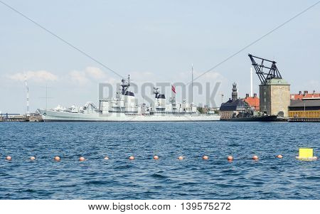 waterside scenery with warship in Copenhagen the capital city of Denmark