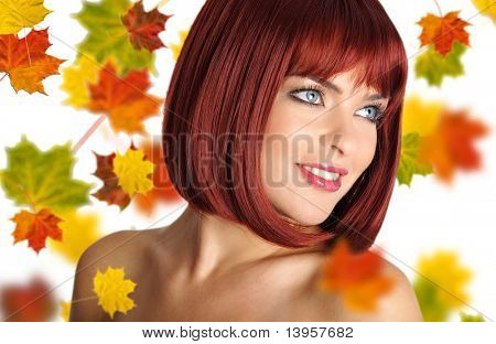 Beautiful young Woman with red Hair Amd Ahorn Blätter