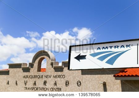 ALBUQUERQUE, USA - MAY 24, 2015: Facade of the Alvarado Transportation Center with an Amtrak sign in the foreground.