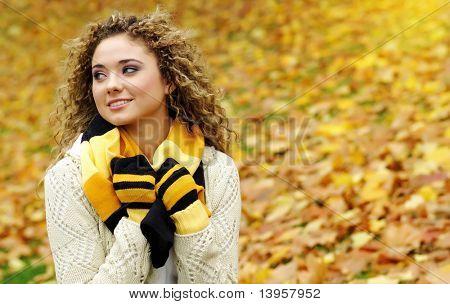Autumn woman in park