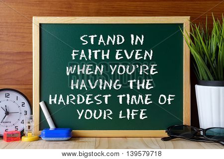 Word Quote Stand In Faith Even When You're Having The Hardest Time Of Your Life Written On Green Cha