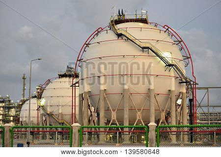 A large oil-refinery tankage and Liquefied  storage tanks.