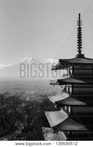 Black and White, Mt. Fuji aerial viewed from behind red Chureito Pagoda, in late winter, Japan