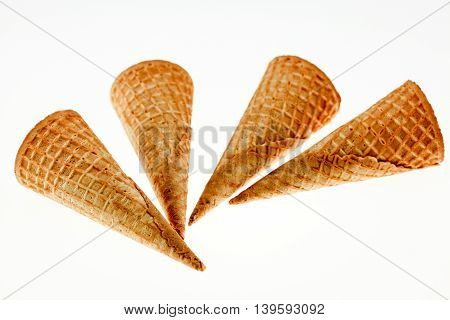 Wafer cup for ice-cream over white background