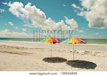 Two Beach Umbrellas on the Sandy Coastline of Anna Maria Island