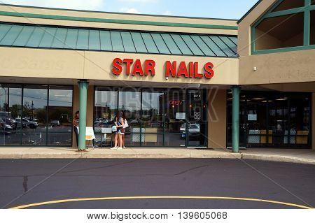 SHOREWOOD, ILLINOIS / UNITED STATES - AUGUST 30, 2015: One may have one's nails trimmed at Star Nails, in a Shorewood strip mall.