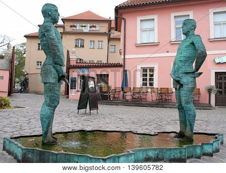 Fountain Pissing Men In Prague