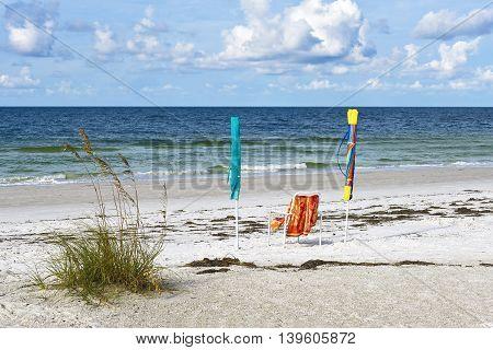 Beach Chair with Umbrellas on the Beach