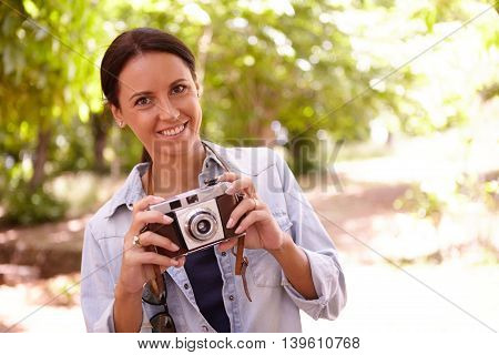 Smiling Young Brunette With Old Camera