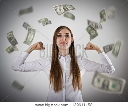 Rejoicing. Strong business woman concept. Girl in white and falling dollar banknotes. Success currency and lottery concept.