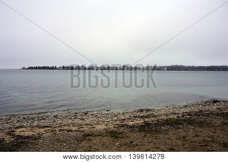 A view of Little Traverse Bay and the Harbor Point Peninsula, as seen from the beach in Wequetonsing, Michigan