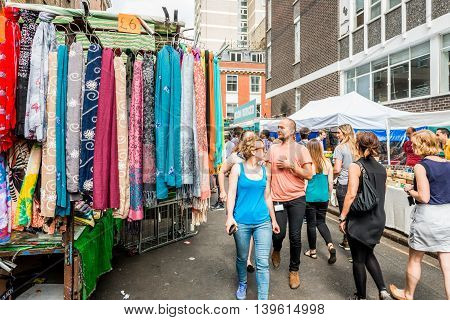 London United Kingdom - July 22 2016: Leather Lane Street Market - street in Holborn with great streetfood fruit and vegetables and clothes stalls very popular with office workers Monday to Friday