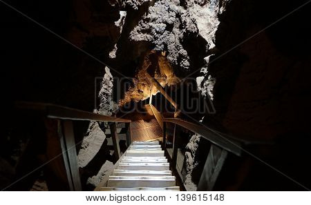A stairwell leading down into a cave