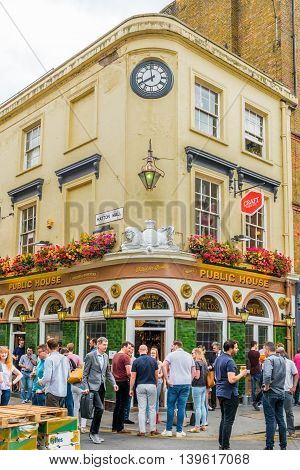 London United Kingdom - July 22 2016: Pub at Leather Lane Street Market - street in Holborn with great streetfood fruit and vegetables and clothes stalls very popular with office workers Monday to Friday