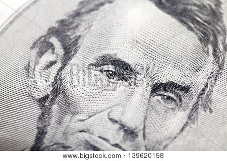 photographed close-up American dollars, small depth of field, banknote worth five dollars