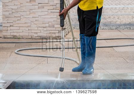 Close Up Outdoor Floor Cleaning With High Pressure Water Jet