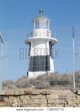 Lighthouse behind barbed wires in Akko Israel