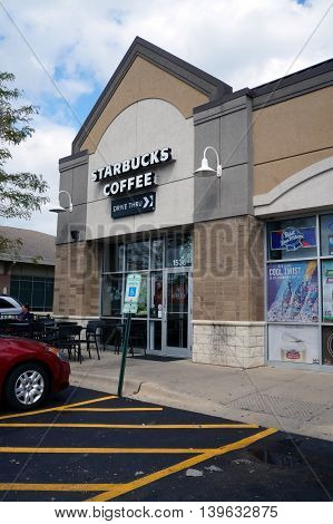 JOLIET, ILLINOIS / UNITED STATES - AUGUST 30, 2015: One may drink Starbucks Coffee in a Joliet strip mall.