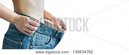 Isolated Closeup Loose Denim Jeans At Waist And Diet Women