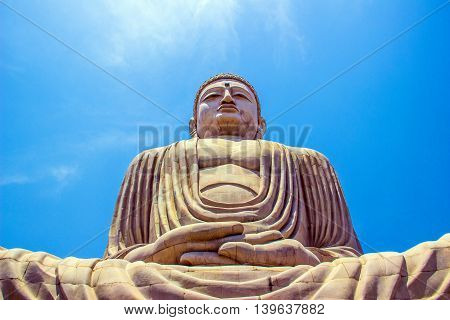 Giant Buddha in Bodhgaya Bihar India under blue sky