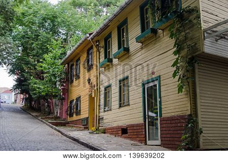 ISTANBUL TURKEY - JUNE 5 2016: Wooden homes on a steep road in Edirnekapi a suburb in the west of Istanbul Turkey.