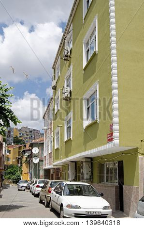 ISTANBUL TURKEY - JUNE 5 2016: View along a street of apartments in the Balaat suburb of Istanbul on a sunny day in early summer.