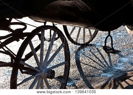fiaker wheel with shadow in Vienna, Austria