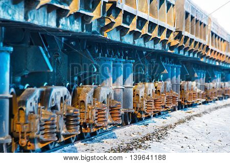Freight train for dry bulk cargoes, bogies and wheels.