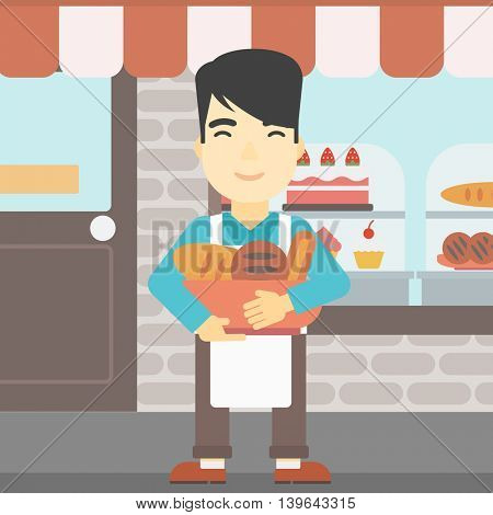 An asian young baker holding basket with bakery products. Baker standing in front of bakery. Baker with bowl full of bread. Vector flat design illustration. Square layout.