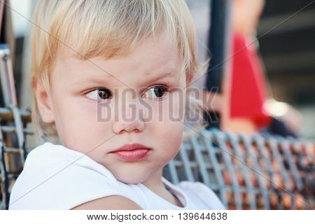 Displeased Cute Caucasian Blond Baby Girl