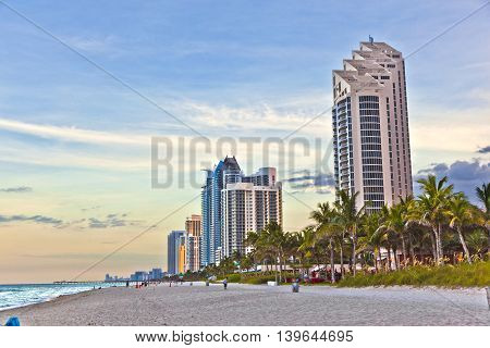 Miami beach with skyscrapers and beach in late afternoon