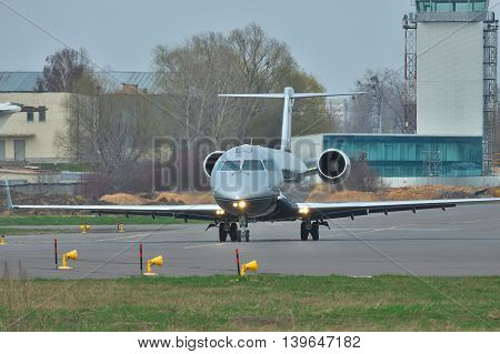 Kiev Ukraine - April 14 2012: Bombardier Challenger 850 Business Jet is taxiing to the runway for takeoff