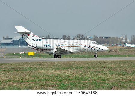 Kiev Ukraine - April 14 2012: Hawker 850XP business jet is preparing for takeoff on runway