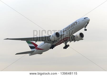 MOSCOW, RUSSIA - SEPTEMBER 26, 2014: Boeing 777-200 Emirates airlines take off at Domodedovo international airport