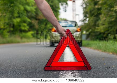 Driver Putting Out A Traffic Warning Sign