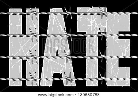 The word hate behind a barbed wire fence over a black background