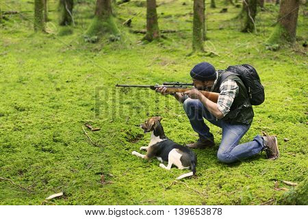 Interracial hunter man in the forest. Sport hunting