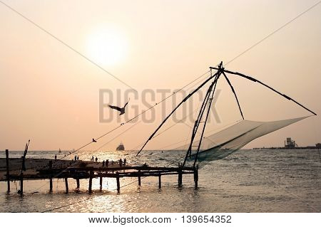 Kochi, Kerala, India, March 28, 2013 - Fishing nets at sunset symbol of the city of Cochin, in March 28, 2013 in Cochin, Kerala, India.
