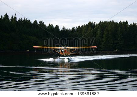 Seaplane landing near Kodiak City on Kodiak Island in Alaska